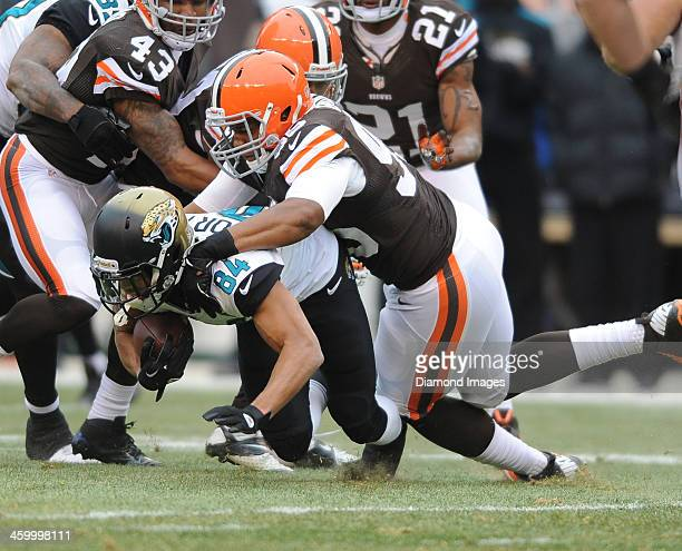 Receiver Cecil Shorts III of the Jackson villa Jaguars is tackled by defensive linemen Armonty Bryant of the Cleveland Browns during a game against...