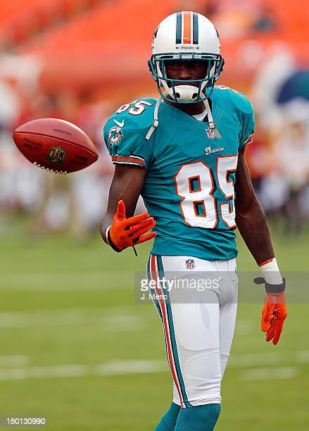 Receiver Chad Johnson of the Miami Dolphins warms up just before the start of the NFL Preseason Game against the Tampa Bay Buccaneers at Sun Life...