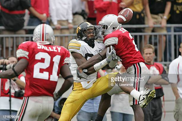 Receiver Clinton Solomon of the Iowa Hawkeyes attempts to make a reception as Malcolm Jenkins of the Ohio State Buckeyes defends at Ohio Stadium in...