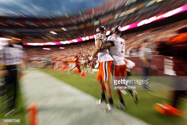 Receiver Corey Fuller of the Virginia Tech Hokies and teammate Marcus Davis celebrate after Fuller's touchdown against the Cincinnati Bearcats during...