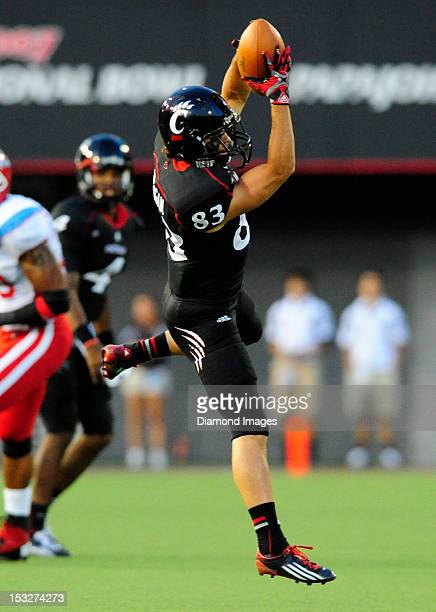Receiver Danny Milligan of the Cincinnati Bearcats catches a pass during a game with the Delaware State Hornets at Nippert Stadium in Cincinnati Ohio...