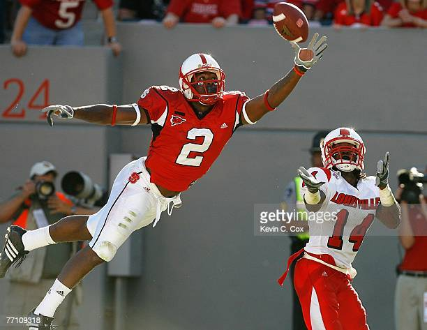 Receiver Darrell Blackman of the North Carolina State Wolfpack fails to pull in this touchdown reception against cornerback Rod Council of the...