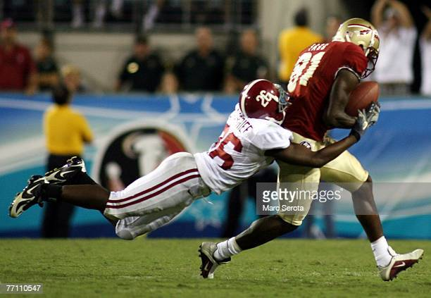Receiver De'Cody Fagg of the Florida State Seminoles catches a pass in front of Ali Sharrief during his teams 2114 victory September 29 2007 at...