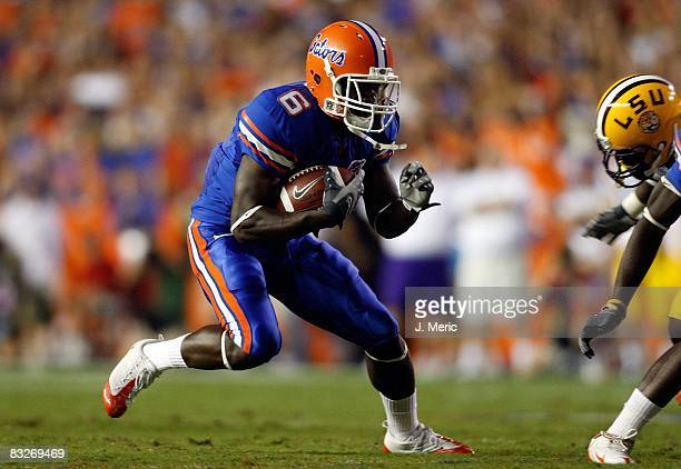 Receiver Deonte Thompson of the Florida Gators runs for additional yardage after a catch against the LSU Tigers during the game on October 11, 2008...