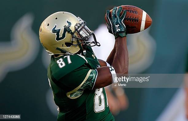 Receiver Derrick Hopkins of the South Florida Bulls catches a pass during warm ups just before the start of the game against the University of Texas...