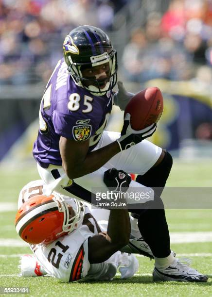 Receiver Derrick Mason of the Baltimore Ravens lunges for yardage as Brodney Pool of the Cleveland Browns defends during the first half October 16,...