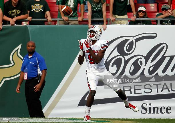 Receiver DeVante Parker of the Louisville Cardinals catches a touchdown pass against the South Florida Bulls during the game at Raymond James Stadium...