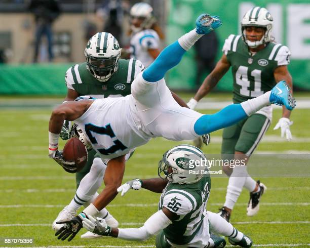 Receiver Devin Funchess of the Carolina Panthers is upended by Marcus Maye of the New York Jets after making a reception and run in an NFL football...