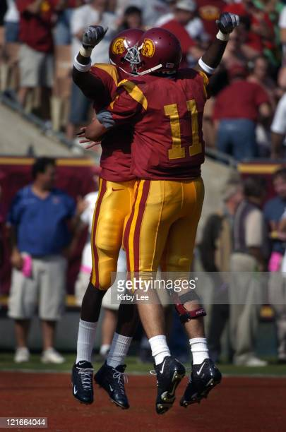 USC receiver Dwayne Jarrett and quarterback Matt Leinart celebrate 16yard touchdown completion during 2317 victory over Cal at the Los Angeles...
