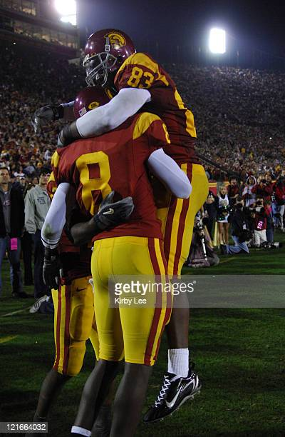Receiver Dwayne Jarrett is congratulated by Fred Davis after scoring on a 43-yard touchdown reception the fourth quarter of 44-24 victory over Notre...