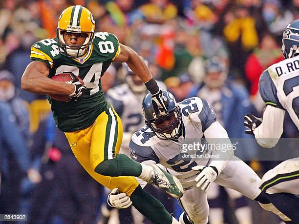 Receiver Javon Walker of the Green Bay Packers breaks away from cornerback Shawn Springs of the Seattle Seahawks during a game on January 4 2004 at...