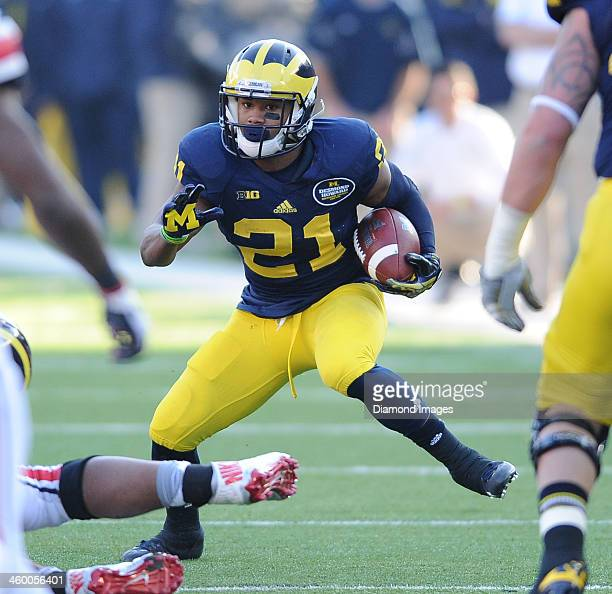 Receiver Jeremy Gallon of the Michigan Wolverines runs wight he football after a reception during a game against the Ohio State Buckeyes at Michigan...