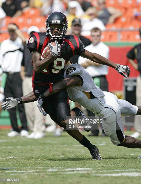 Receiver Joe Smith of Arkansas State tries to elude Tiger defenders during a game against the Missouri Tigers at Arrowhead Stadium in Kansas City Mo...