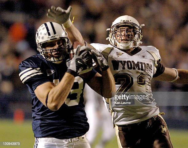 BYU receiver Jonny Harline hauls in a 27 yard pass from John Beck as Wyoming defender John Wending defends at LaVell Edwards Stadium in Provo Utah...