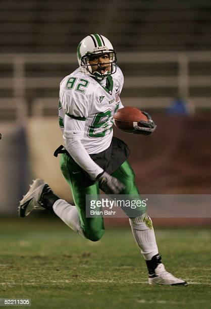 Receiver Josh Davis of the Marshall Thundering Herd runs upfield against the Cincinnati Bearcats on December 23 2004 in the Plains Capital Fort Worth...