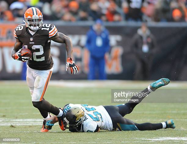 Receiver Josh Gordon of the Cleveland Browns runs away from linebacker Russell Allen of the Jacksonville Jaguars during a game against the...