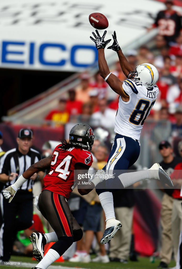 Receiver Malcom Floyd #80 of the San Diego Chargers catches a pass in front of safety Mark Barron #24 of the Tampa Bay Buccaneers during the game at Raymond James Stadium on November 11, 2012 in Tampa, Florida.