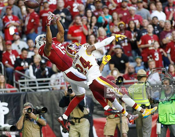 Receiver Michael Floyd of the Arizona Cardinals has the ball go off his finger tips in the endzone as Josh Norman of the Washington Redskins defends...