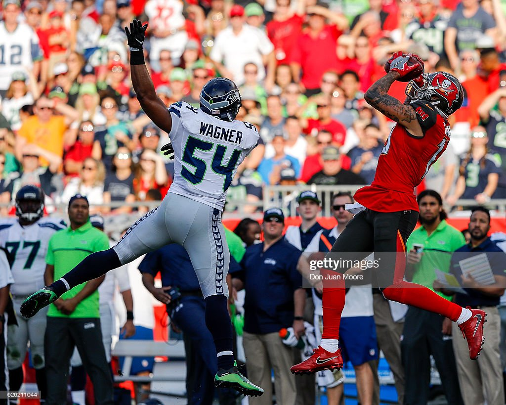 Receiver Mike Evans #13 of the Tampa Bay Buccaneers makes a catch over Linebacker Bobby Wagner #54 of the Seattle Seahawks during the game at Raymond James Stadium on November 27, 2016 in Tampa, Florida. The Bucs defeated the Seahawks 14 to 5.