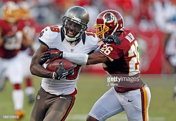 Receiver Mike Williams of the Tampa Bay Buccaneers is tackled by defender Josh Wilson of the Washington Redskins during the game at Raymond James...