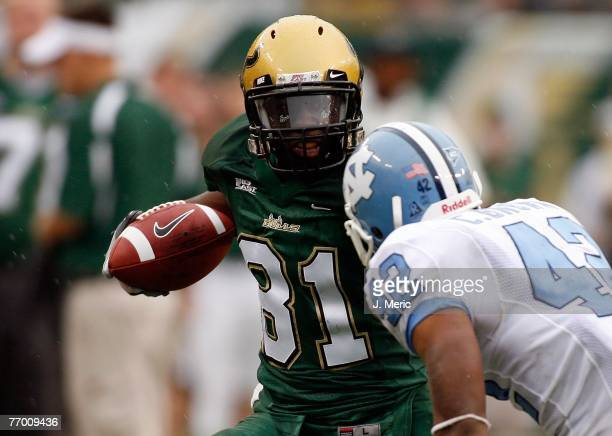 Receiver Patrick Richardson of the South Florida Bulls looks to get past cornerback Charles Brown of the North Carolina Tar Heels during the game on...