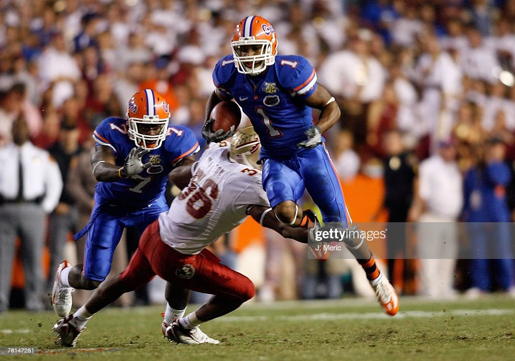 Receiver Percy Harvin #1 of the Florida Gators looks for some yardage during the game against the Florida State Seminoles on November 24, 2007 at Ben Hill Griffin Stadium at Florida Field in Gainesville, Florida.