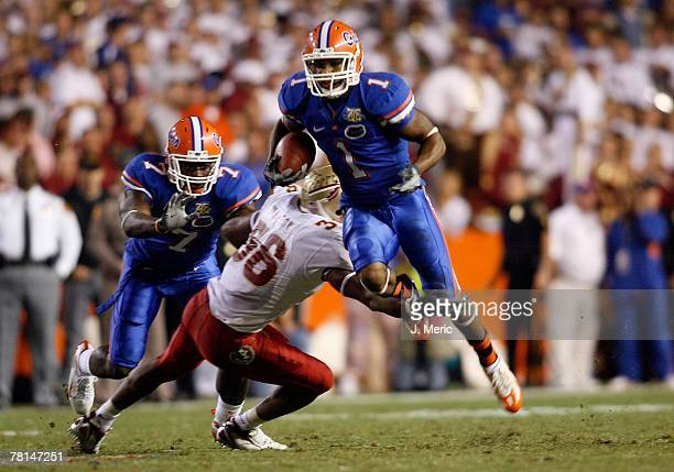 Receiver Percy Harvin of the Florida Gators looks for some yardage during the game against the Florida State Seminoles on November 24, 2007 at Ben...