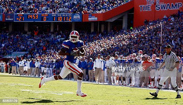 Receiver Percy Harvin of the Florida Gators runs for a touchdown against the Citadel Bulldogs during the game at Ben Hill Griffin Stadium at Florida...