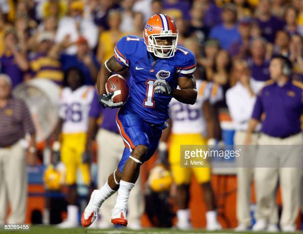Receiver Percy Harvin of the Florida Gators scores a first quarter touchdown against the LSU Tigers during the game on October 11, 2008 at Ben Hill...