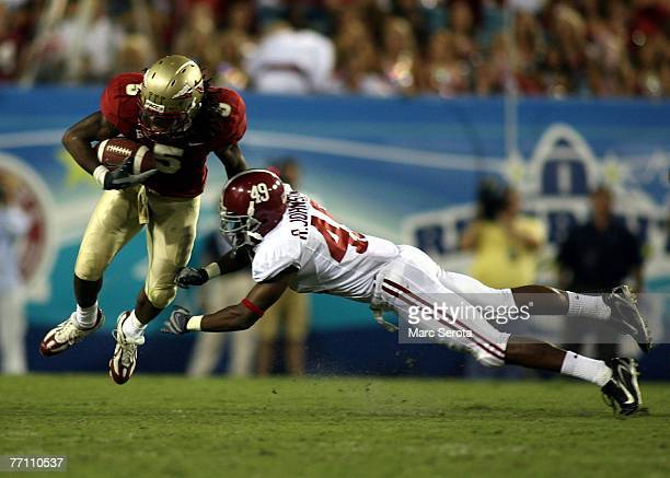 Receiver Preston Parker of the Florida State Seminoles catches a pass in front of Rashad Johnson during his teams 21-14 victory September 29, 2007 at...