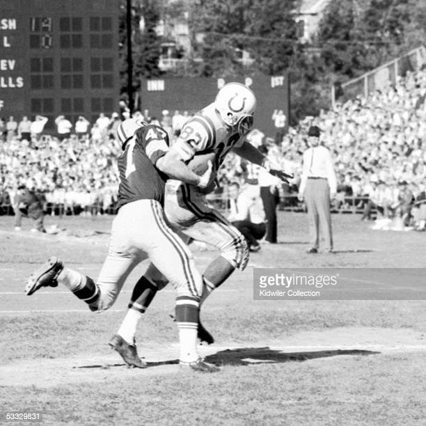 Receiver Raymond Berry of the Baltimore Colts catches a pass in front of Jesse Whittenton of the Green Bay Packers during a game on October 18 1964...