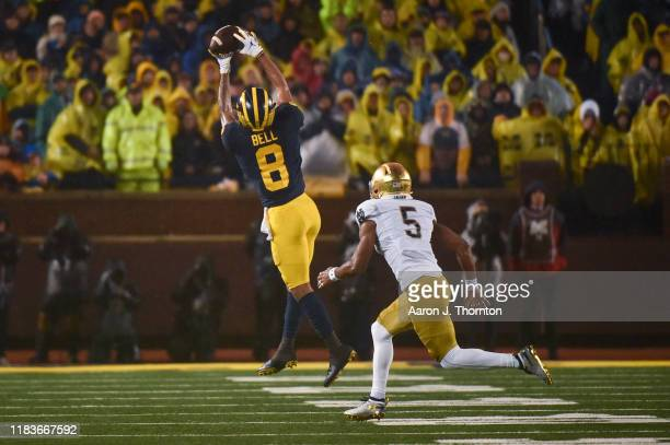 Receiver Ronnie Bell of the Michigan Wolverines attempts to catch a pass during a college football game against the Notre Dame Fighting Irish at...