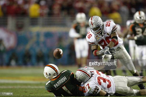 Receiver Roscoe Parrish of the Miami Hurricanes fumbles the football after being hit by Dustin Fox of the Ohio State Buckeyes during the Tostitos...