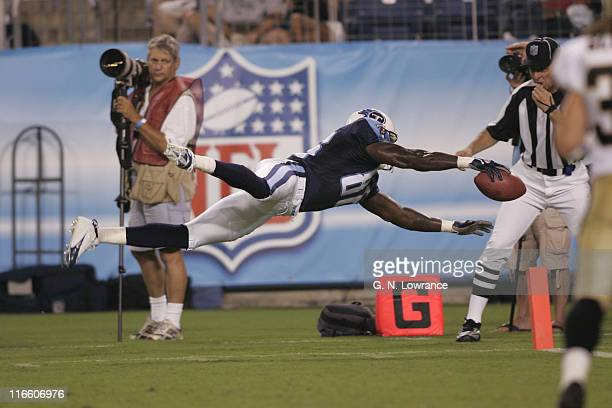 Receiver Roydell Williams of the Titans dives after a reception during action between the New Orleans Saints and the Tennessee Titans at LP Field in...