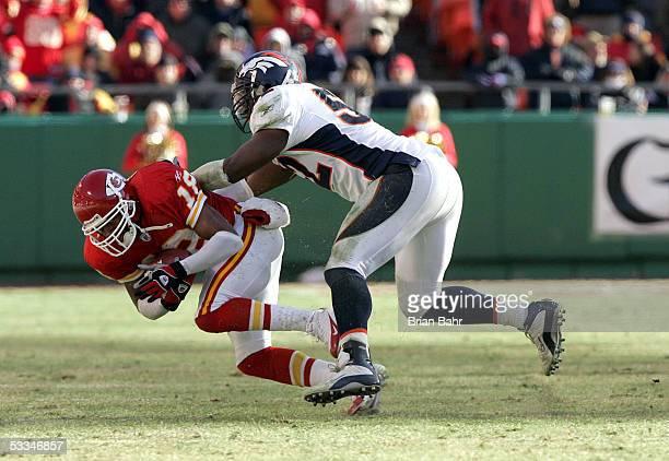 Receiver Samie Parker of the Kansas City Chiefs is tackle by Denver Broncos linebacker DJ Williams on December 19 2004 at Arrowhead Stadium in Kansas...