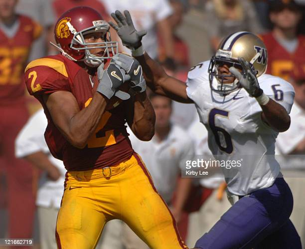 Receiver Steve Smith makes a catch over the outstretched hands of Washington's Matt Fountaine for a 51-yard gain in Pacific-10 Conference game at the...