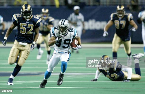 Receiver Steve Smith of the Carolina Panthers gets behind the St. Louis Rams defense to score the winning touchdown in overtime in the NFC Divisional...