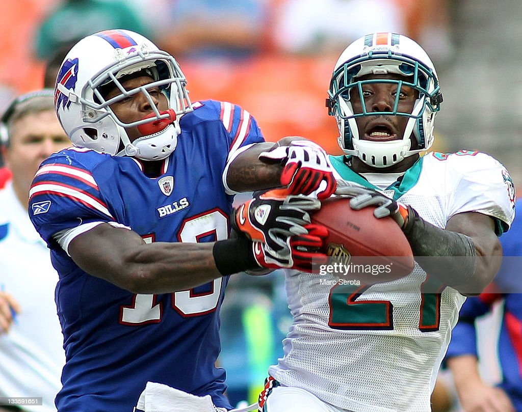 Receiver Stevie Johnson #13 Of The Buffalo Bills Is Defended By Cornerback  Vontae Davis #