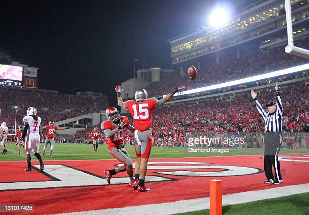 Receivers Devin Smith and Corey Brown of the Ohio State Buckeyes celebrate after a Smith game winning touchdown catch during a game with the...