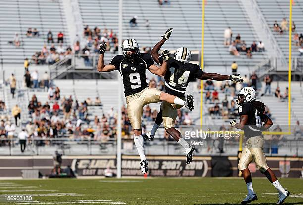 Receivers J.J. Worton and Quincy McDuffie of the Central Florida Knights celebrate a touchdown against the Alabama Birmingham Blazers during the game...