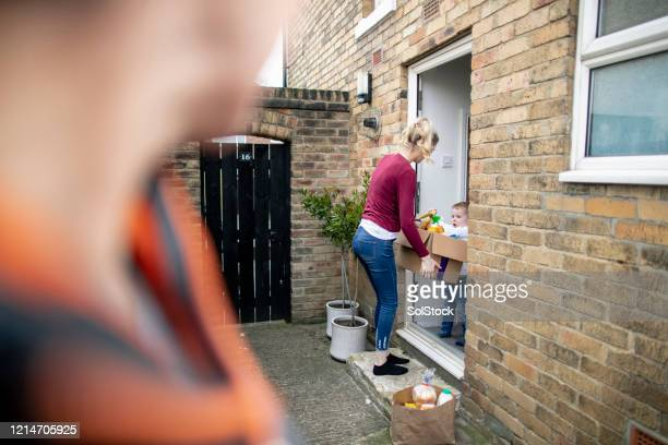 receiving goods at doorstep - corona stock pictures, royalty-free photos & images