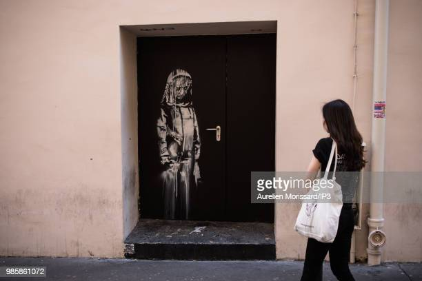 A recent artwork by street artist Banksy on a side street to the Bataclan concert hall where a terrorist attack killed 90 people on Novembre 13 on...