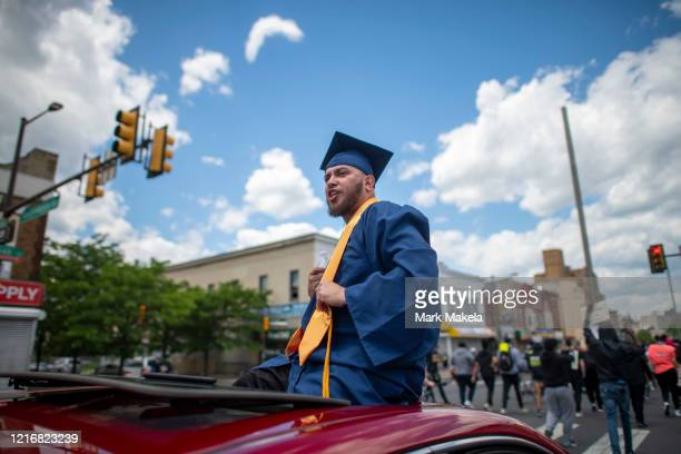 A recent graduate addresses police officers during a protest march in the aftermath of widespread unrest following the death of George Floyd on June...