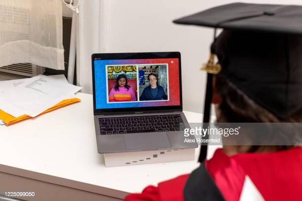 A recent graduate watches Mindy Kaling and B J Novak speak during a virtual graduation ceremony held by Facebook from his laptop on May 15 2020 in...