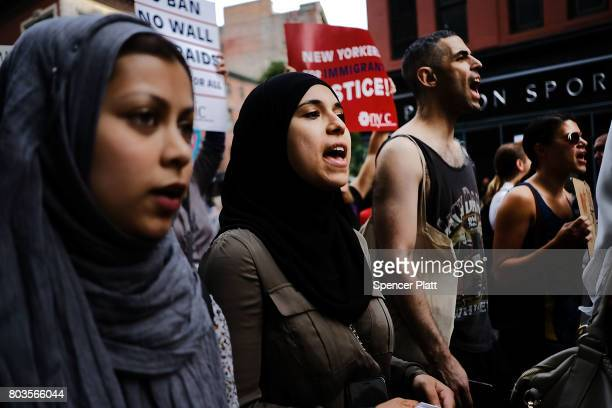 Recent Immingrants join activists for an evening protest in Manhattan hours before a revised version of President Donald Trump's travel ban that was...