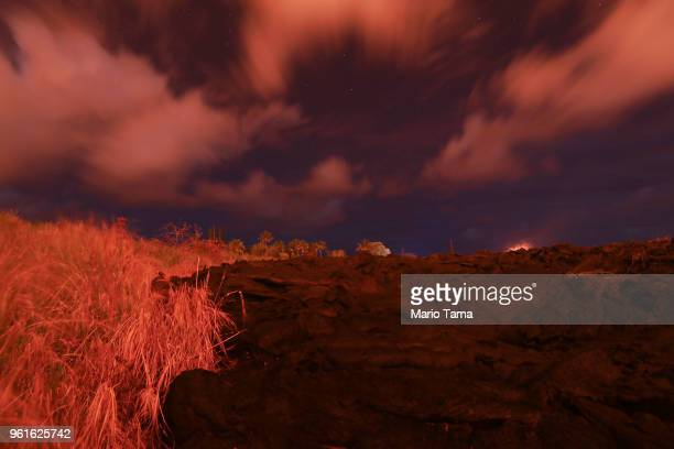 A recent lava flow from a Kilauea volcano fissure sits in a field at night on Hawaii's Big Island on May 22 2018 in Kapoho Hawaii One week ago prior...