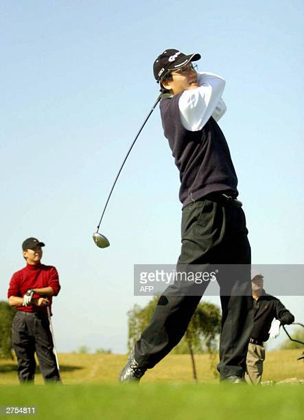 A recent photo dated 10 October 2003 shows a group of wealthy Chinese playing a round of golf at an exclusive golf club in the suburbs of Beijing In...