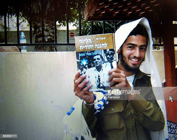 A recent photo made available by an extremist Jewish settler August 5 2005 shows Israeli gunman Eden NatanZada posing for a photo holding a book by...