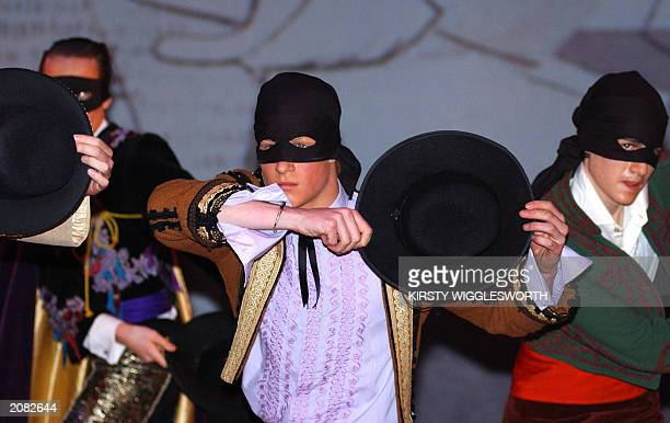 Recent photo of the Prince Harry the younger son of the Prince of Wales as Conrade in a scene featuring a masked ball during an Eton College...