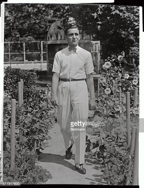 A recent photograph of Irving Berlin taken at the Hollywood home of Joseph M Schench is seen here The noted songwriter will reside here while on the...